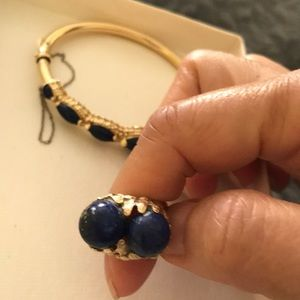 Gold ring with blue stones